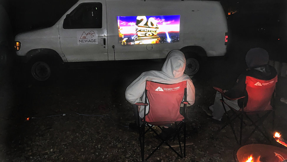 Movie night by the fire with the portable projector
