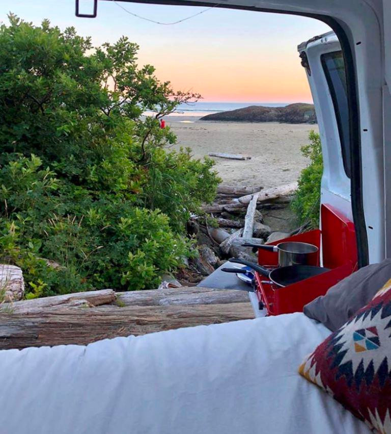 Vanlife cooking by the beach