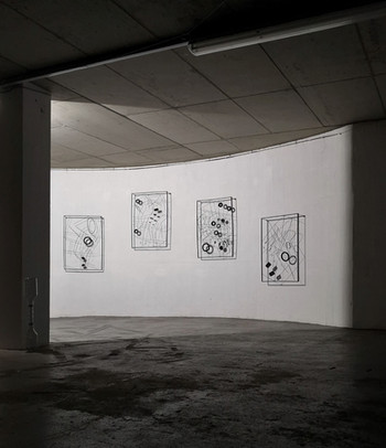 Four Frames on a Curved Wall