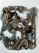 bab2 metal piece hand held.jpg