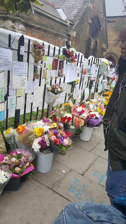 Flower tributes at the church site