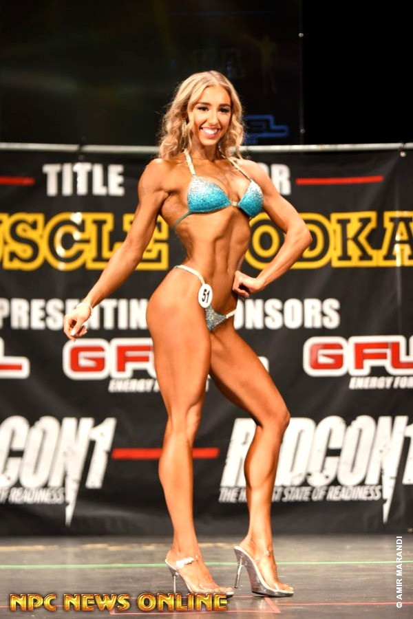 Client Christine Kuzminsky on stage
