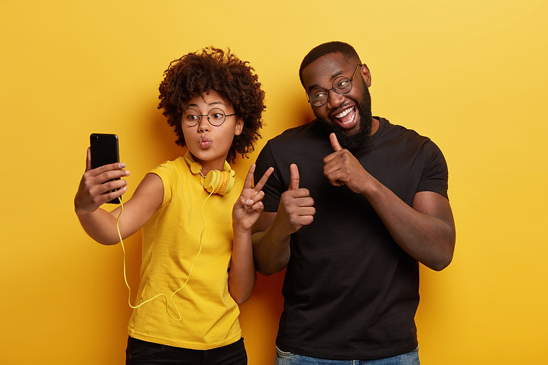young-man-and-woman-taking-selfie.jpg