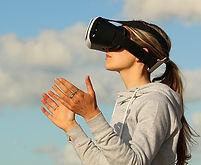 A lady wearing a virtual reality headset