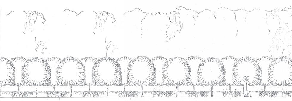 Полотно железной дороги, за ней – парковый пейзаж с регулярной стрижкой деревьев на первом плане. Лирообразная стрелка