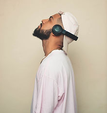 photo-of-man-listening-with-jbl-wireless-headset-3156475_edited.jpg
