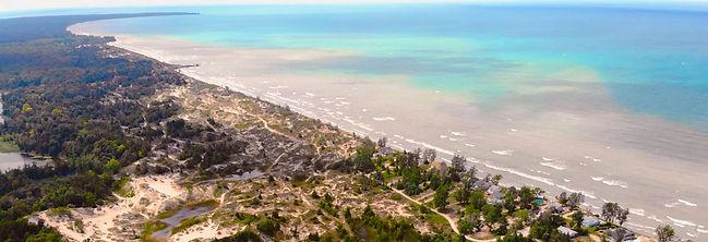 Birds eye view of sand dunes and lake hu