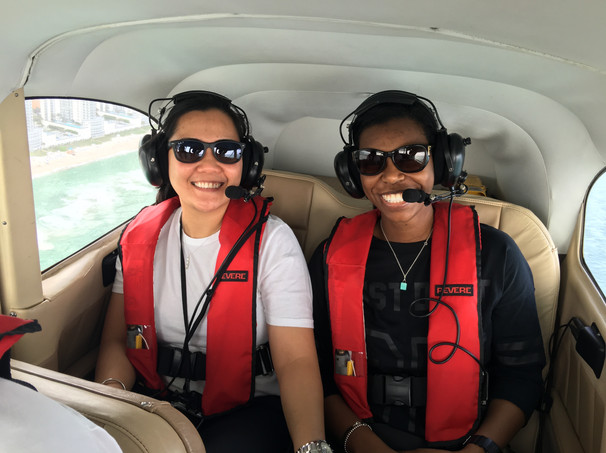 Happy couple flying with Miami Plane Tours