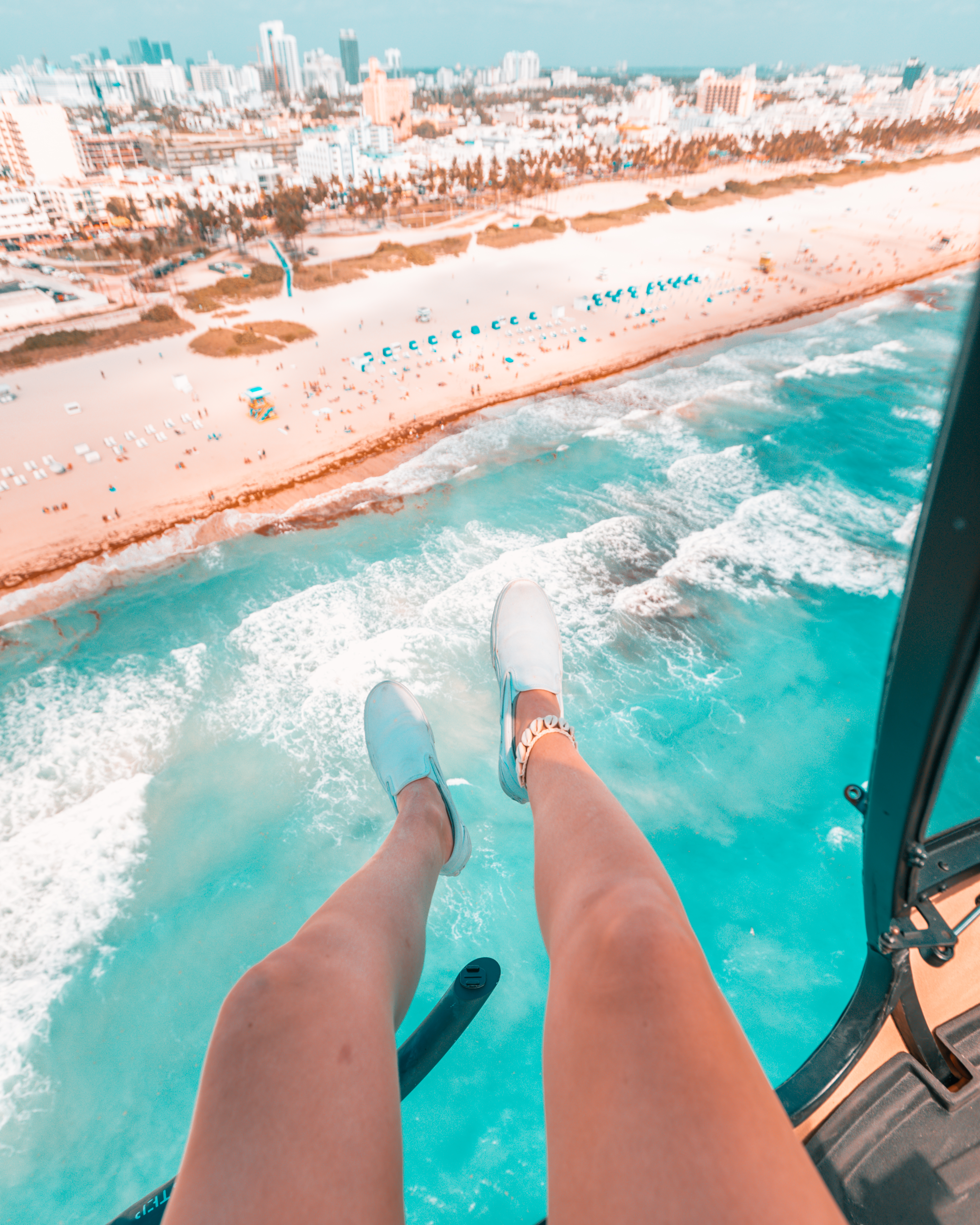 Feet hanging out of a helicopter
