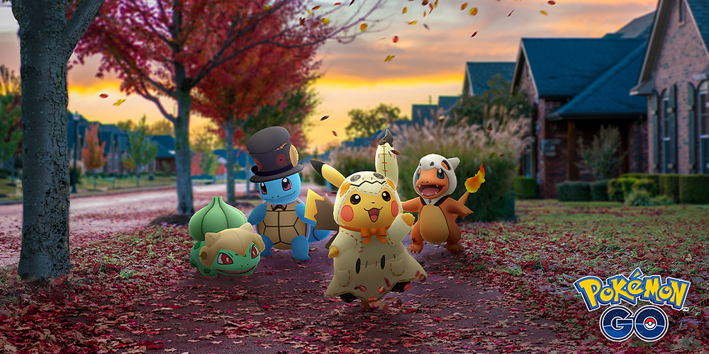 Four Pokémon in costumes walk down a residential street covered in fallen leaves.