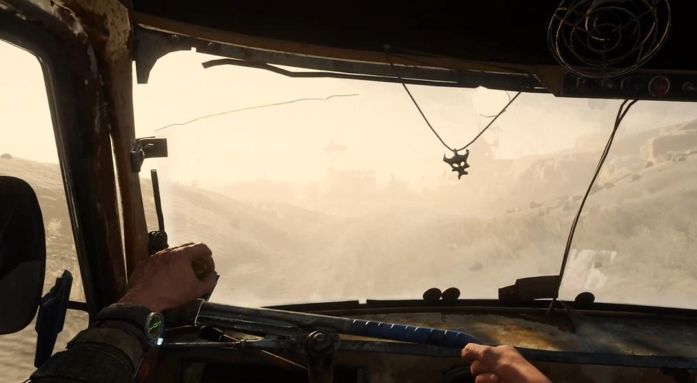 Artyom drives a car through a dusty, desert environment.