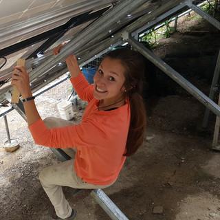 Abby M. works on solar array summer 2019