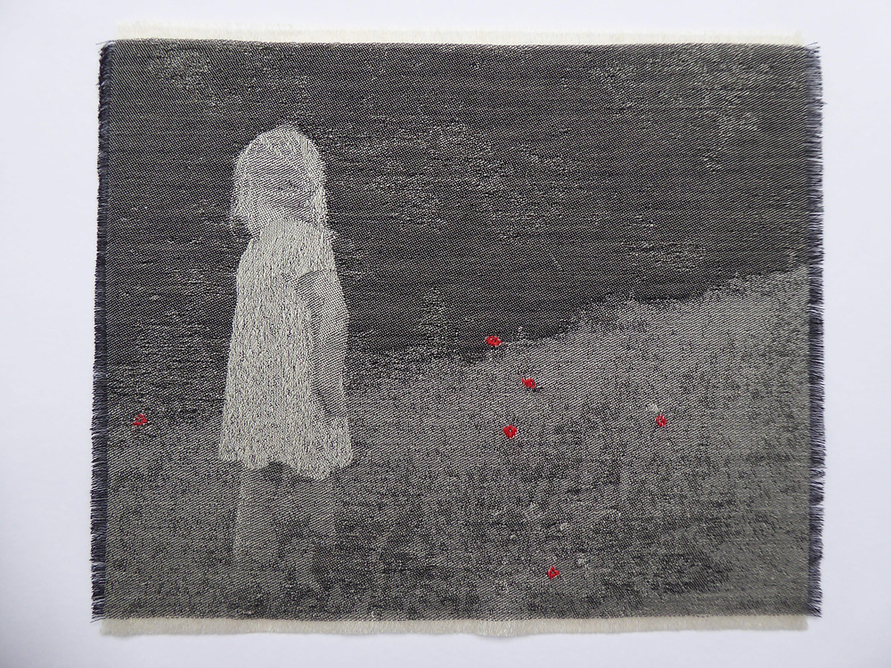 Jacquard weave and hand embroidery of young girl looking at wood