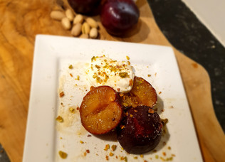 Roasted plums with an almond and pistachio crumble