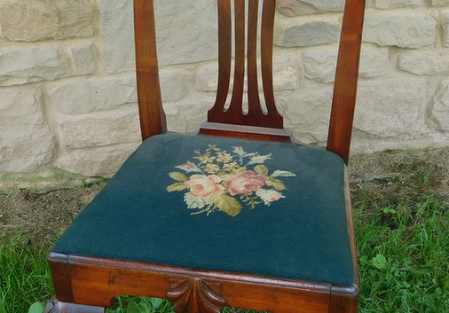 One of two important and rare shell-carved chairs in the auction