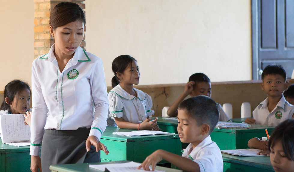 kids, students, nonprofit, Kaleidoscope Child Foundation, desks, teacher, Cambodia, nonprofit, children in classroom