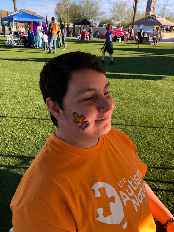 Team members getting their faces painted!