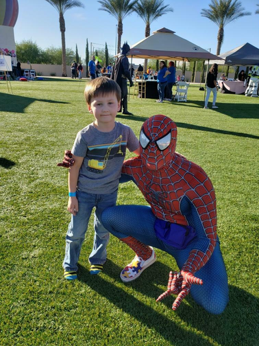 Spiderman and his biggest smol fan.