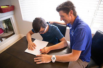 Speech Therapist working with an autistic client.