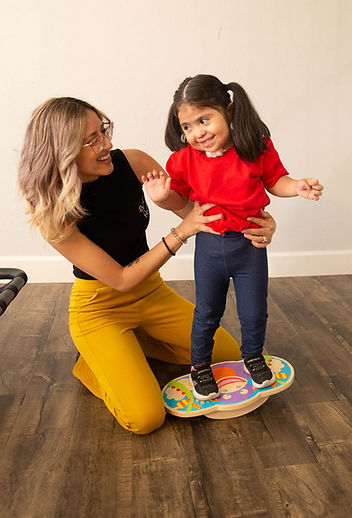 Physical Therapist working with a special needs girl.
