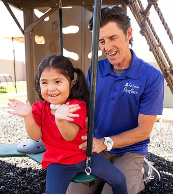 Attendant Care Provider and his client playing safe on the playground.