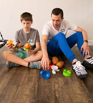 Occupational Therapist working with an autistic client.