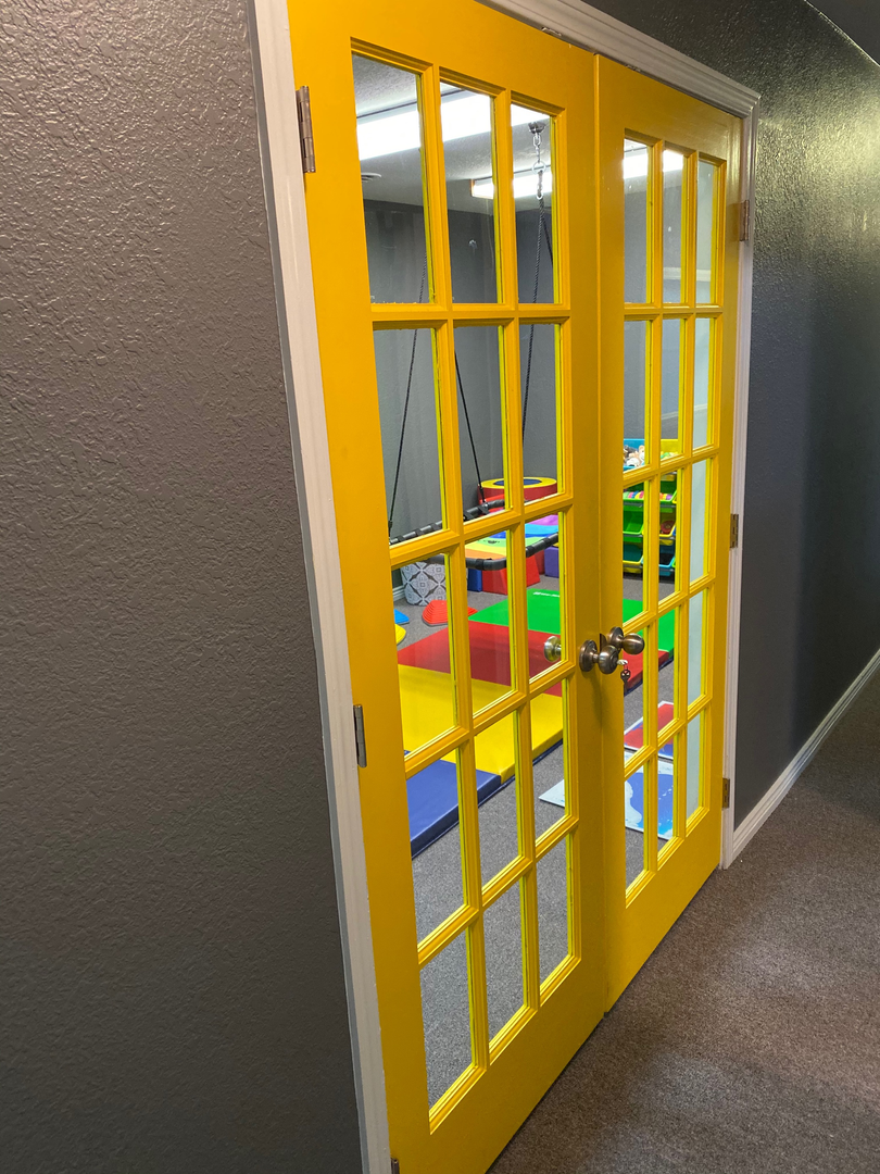 What's behind these big yellow doors?