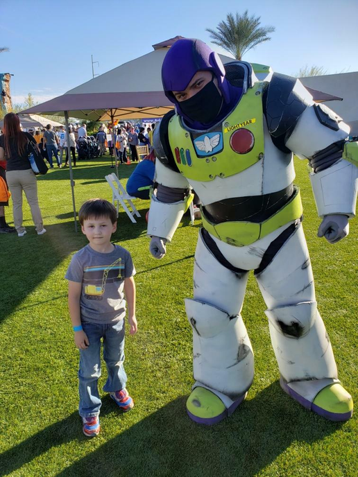 Buzz Lightyear posing for pictures