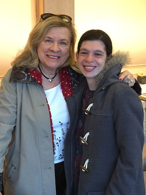 Image of Tori, right, posing with a woman at the Cleveland Pops Orchestra performance.