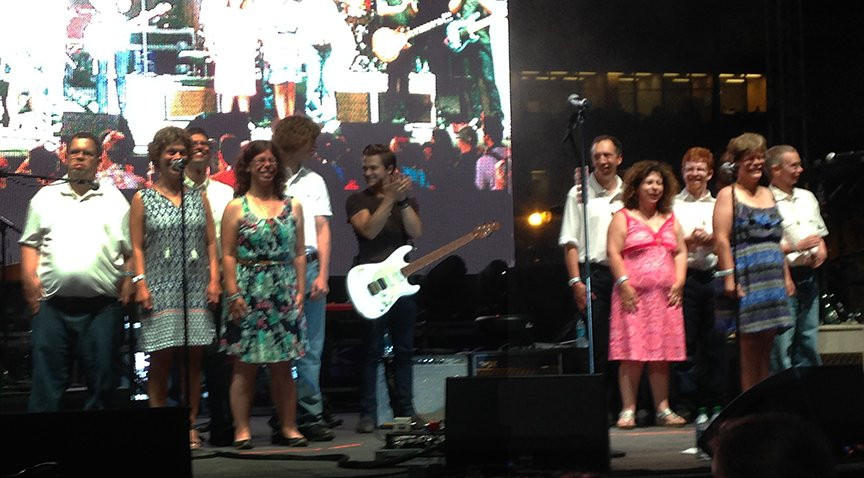 Image of Special Olympics participants on stage with Hunter Hayes.
