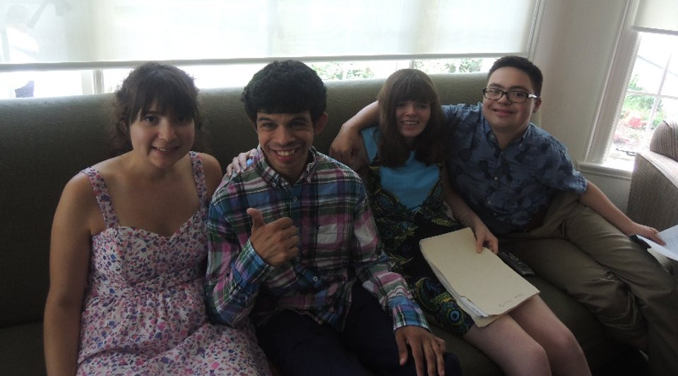 Image of four Summer Program attendees posing together on the couch in the student lounge.