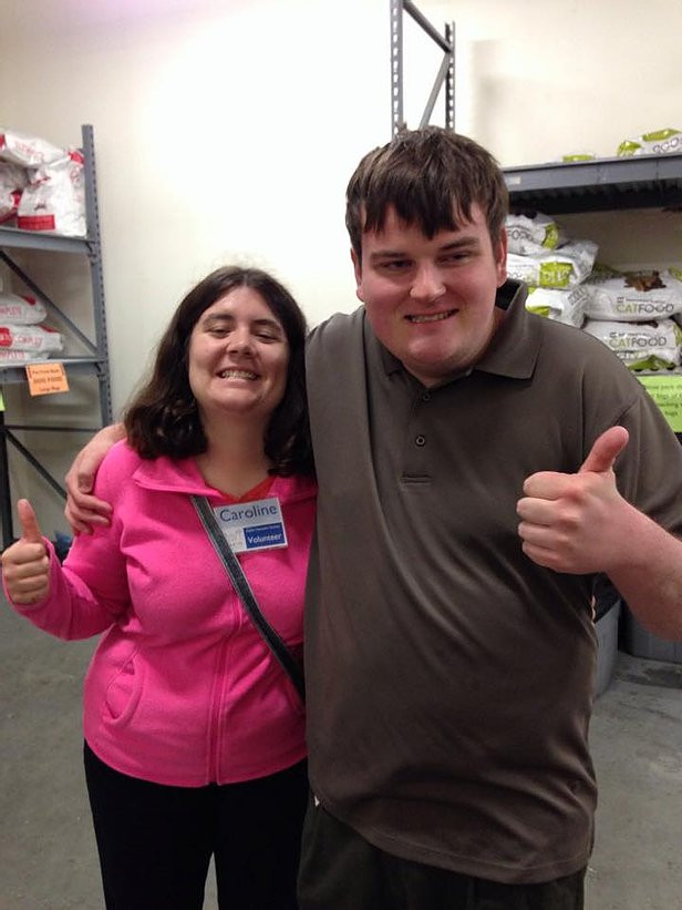Image of Carly and Pat posing together with their thumbs up at Dakin Humane Society.
