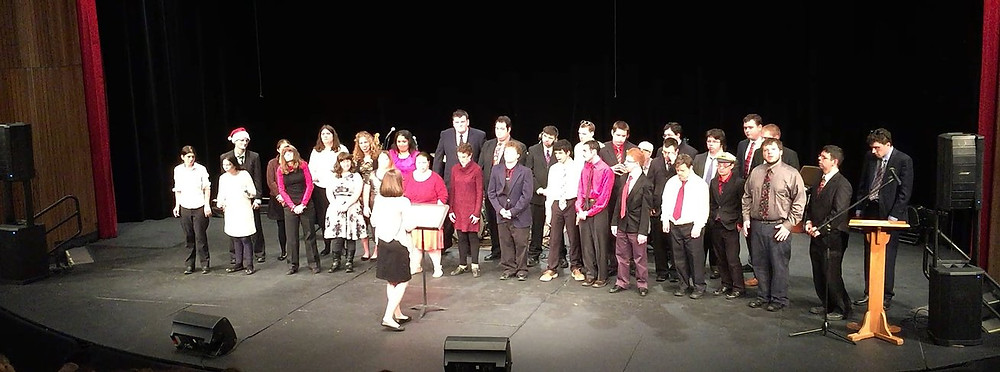 Image of the Berkshire Hills chorus, directed by Michelle Kostek sings on stage at the end-of-semster concert.