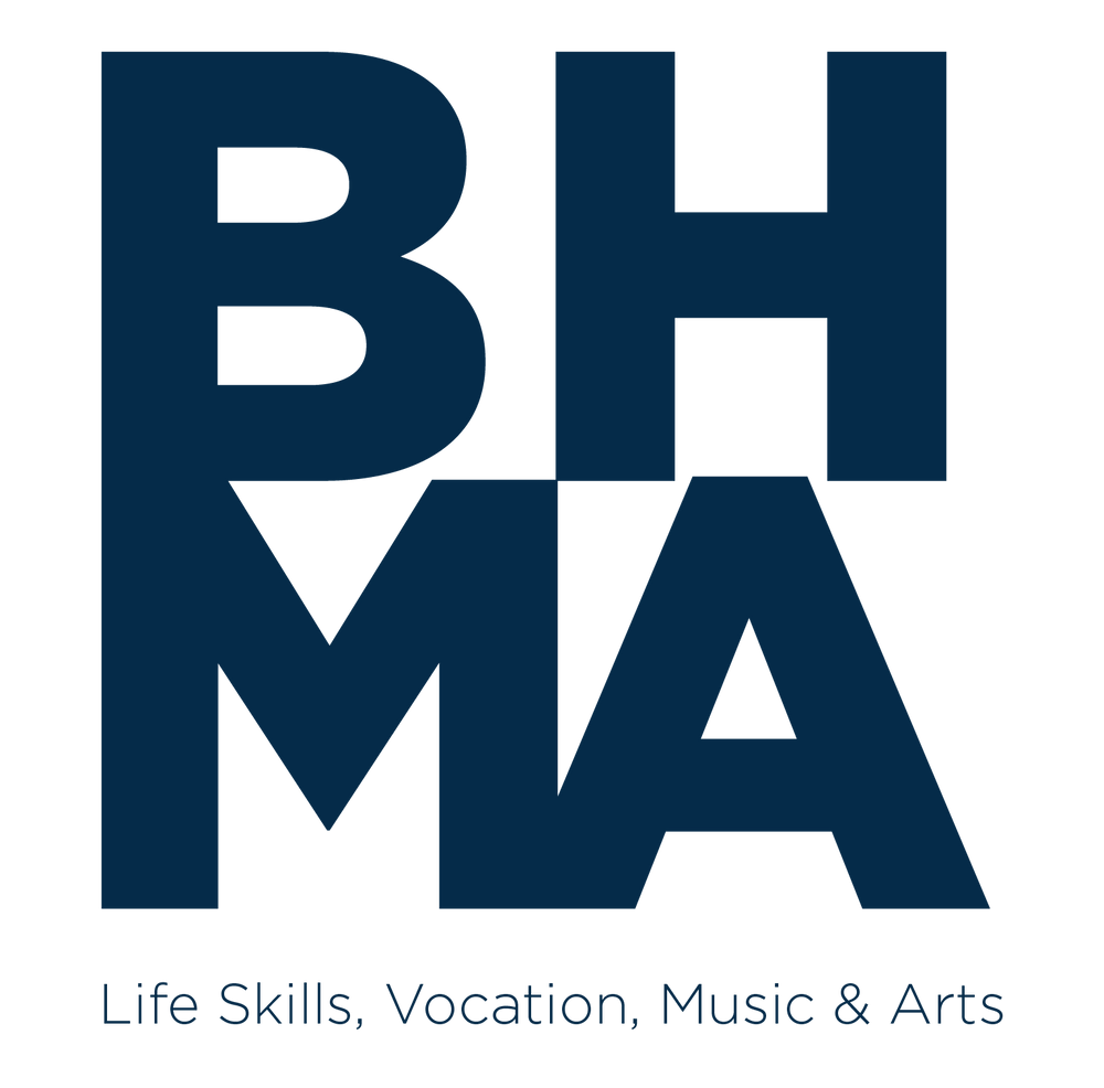 """Image of BHMA's new logo, featuring the letters BH on the top row, with MA on the bottom row; the tagline """"Life Skills, Vocation, Music & Arts"""" is underneath the stacked lettering. All text is navy blue on a white background."""