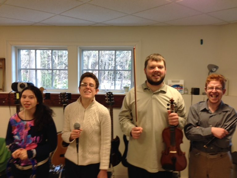 Image of Heather Silva, Mary Westgate, Matt Clougley, and Ben Monkaba posing together in the ensemble room.