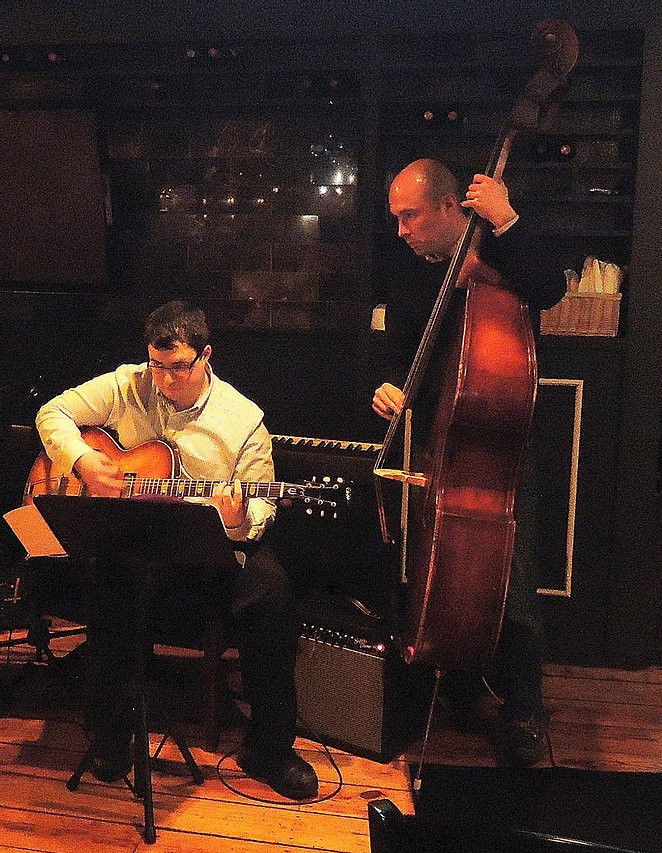 Image of Marco DiSantis playing guitar and Andy Anderson playing the upright bass.
