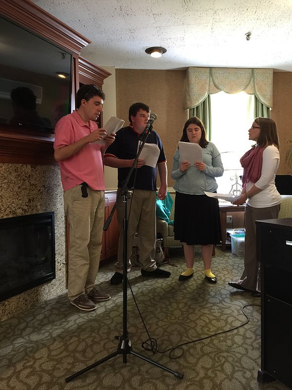 Image of Connor, Pat, and Carly dressed up for fieldwork as they are guided by Instructor Michelle Kostek at a nursing home performance.