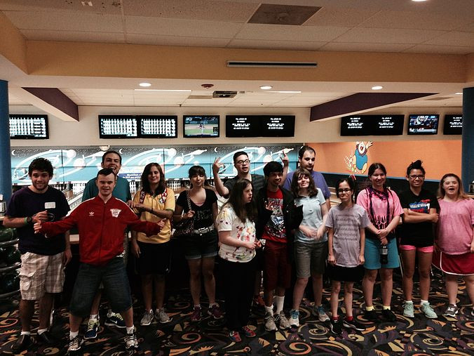 Image of Summer Program participants posing together at the bowling alley.