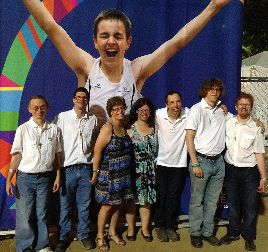 Image of seven Special Olympics participations posing together.