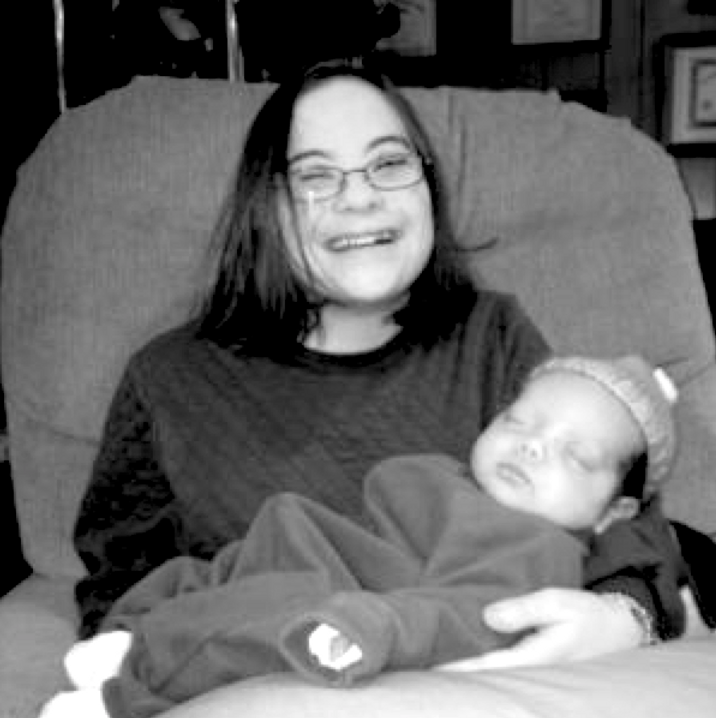 Black and white picture of Ilyse Ross holding her baby niece.