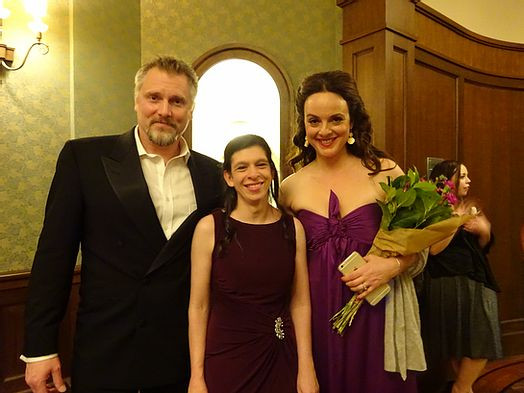 Image of Tori Ackley, center, posing with a man and woman at the Cleveland Pops Orchestra.