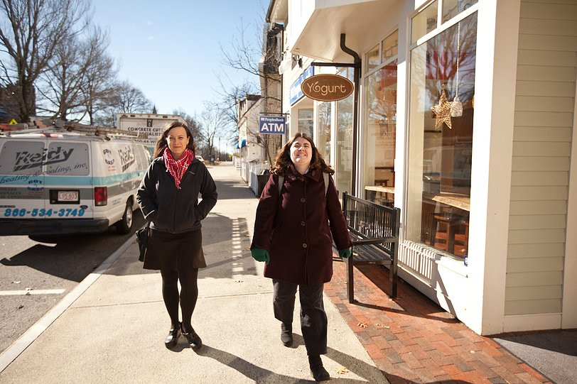Image of Danielle Kelly, left, and Carly Golden, right, walking down the sidewalk at the Commons on their way to the bank.
