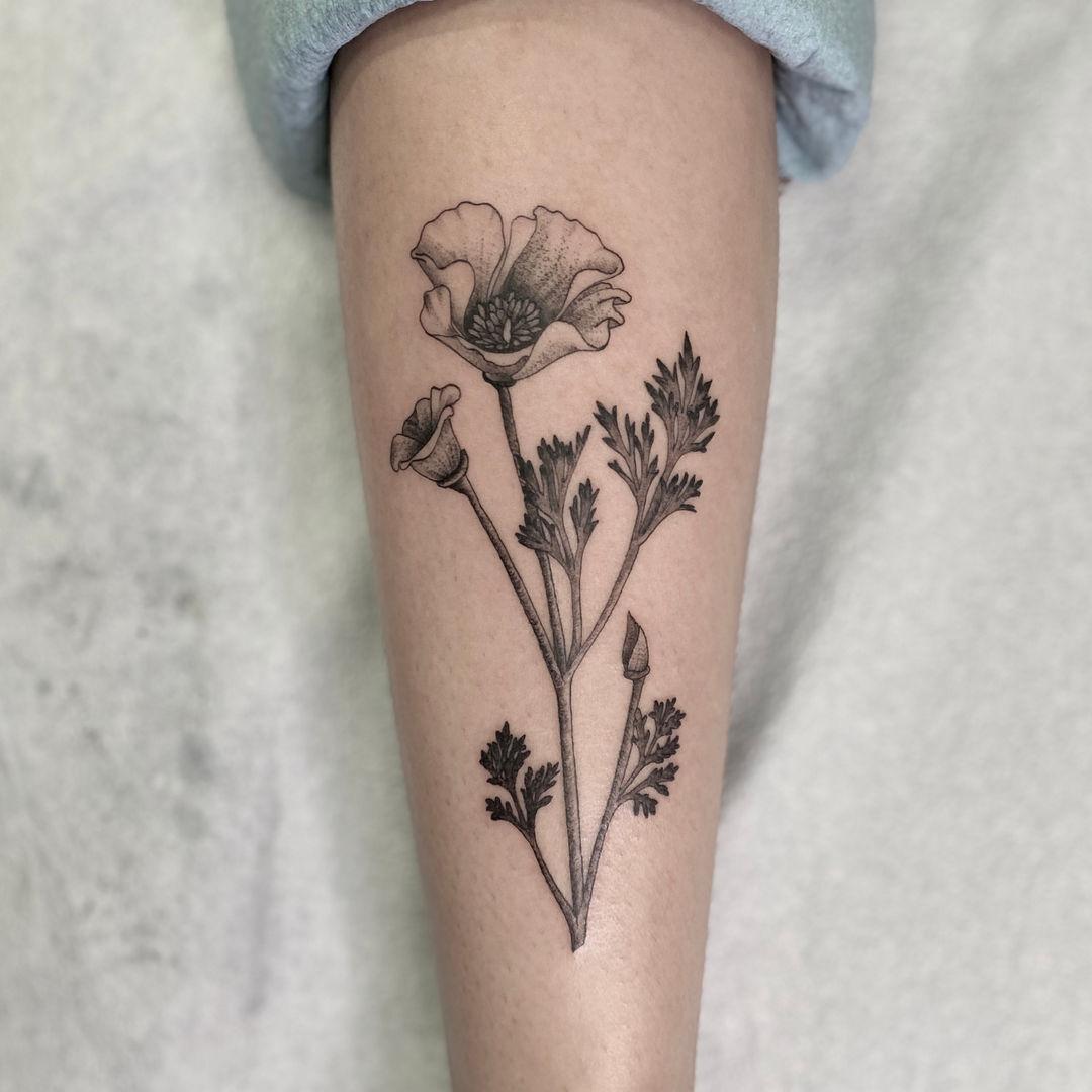 Black and grey flower tattoo