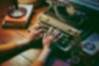 person-using-typewriter-1448709.jpg