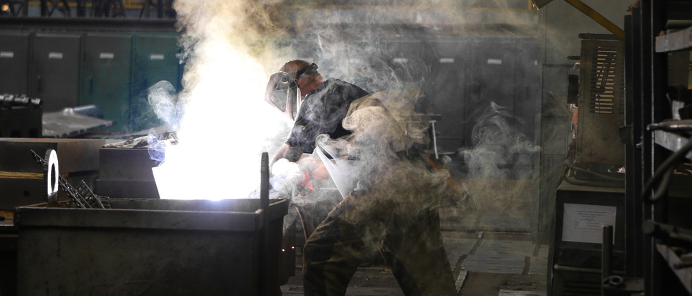 man-wearing-gray-shirt-and-welding-mask-