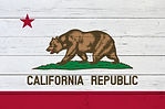 Flag of California on wooden background.