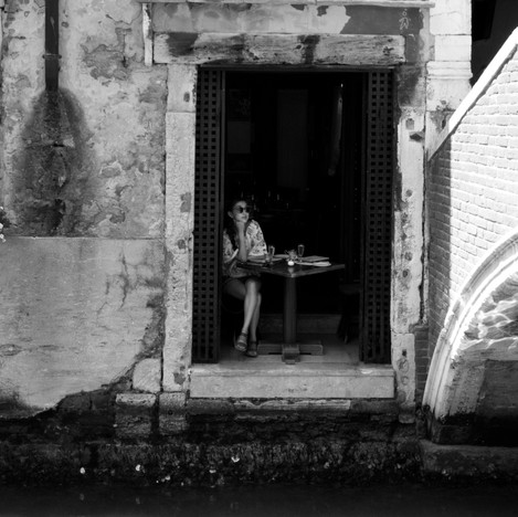 Woman staring out of french window.jpg