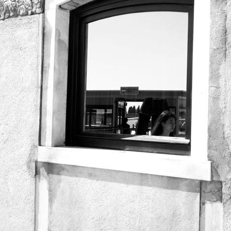 Woman's reflection in window.jpg