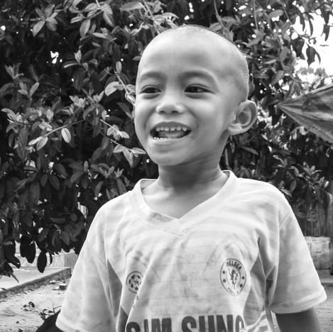Small boy playing on street.jpg