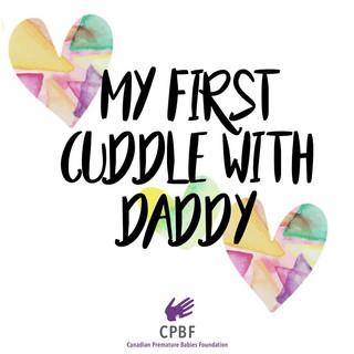 First Cuddle with Dad.jpg